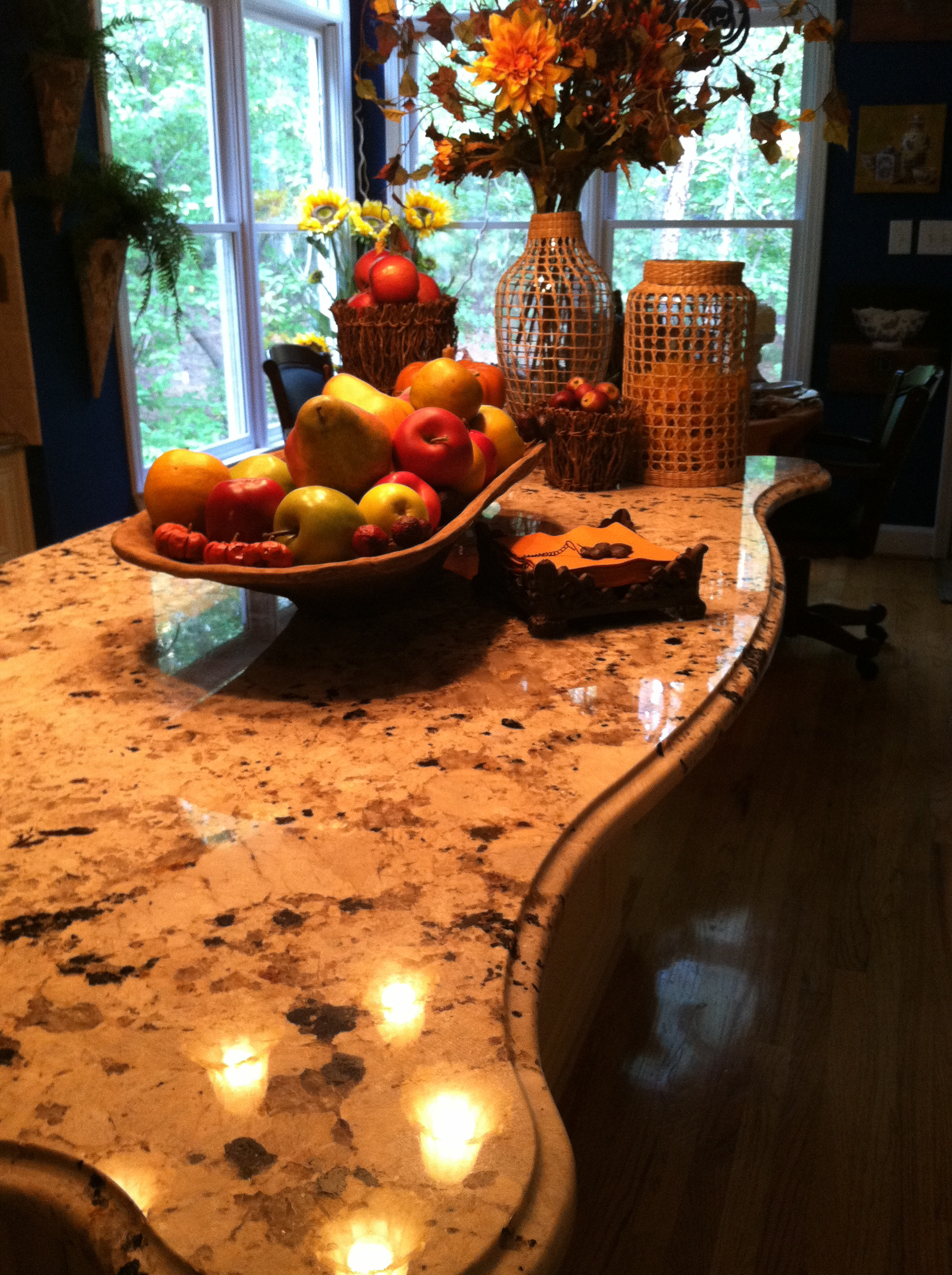 Fill a wooden bowl with real apples and display on your kitchen island.