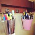 Little buckets holding pins and markers