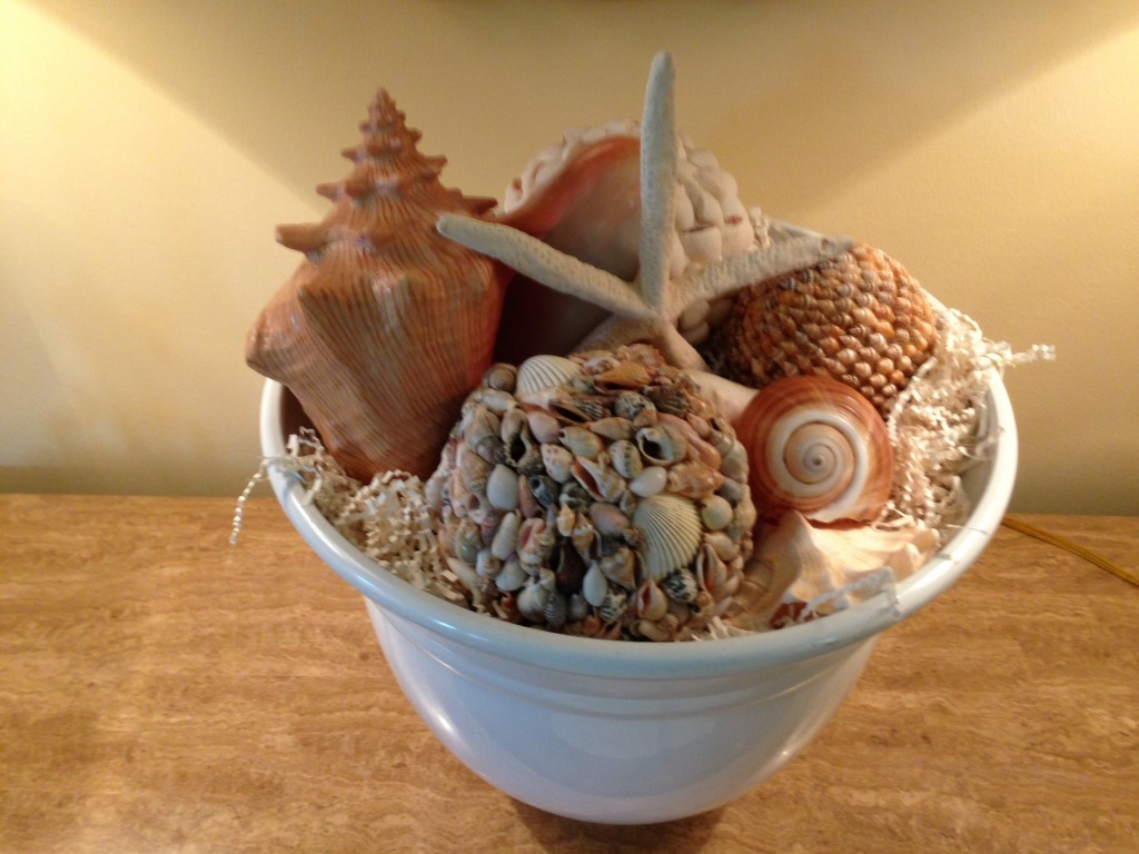 Fill a white ceramic bowl with shells